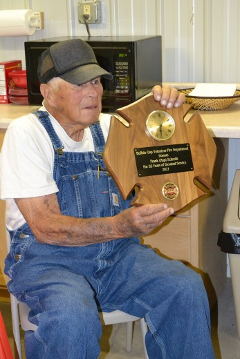 """Frank """"Hap"""" Schroth holds the plaque he was given upon his retirement as chief of the Buffalo Gap Volunteer Fire Department. The plaque was presented at a retirement party at the fire hall on July 19. Schroth turns the job of chief over to his son Randy. Grandson Caleb will serve as first assistant."""