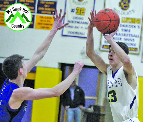 Jace Kelley prepares to let a three-pointer fly during Custer's loss to St. Thomas More last Thursday evening in the Armory. Kelley was the only Wildcat in double figures in the team's 64-27 loss. The Cavaliers came into the game undefeated and ranked number one in the state in Class A.