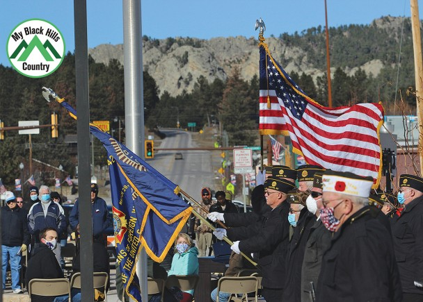 The Custer Veterans Honor Guard presents the colors during the playing of TAPS near the conclusion of the 26th annual Custer School District Veterans Day program last Wednesday. The event was moved from the Armory to Veterans Memorial Park this year because of COVID-19. See more photos of the event on page 6A.