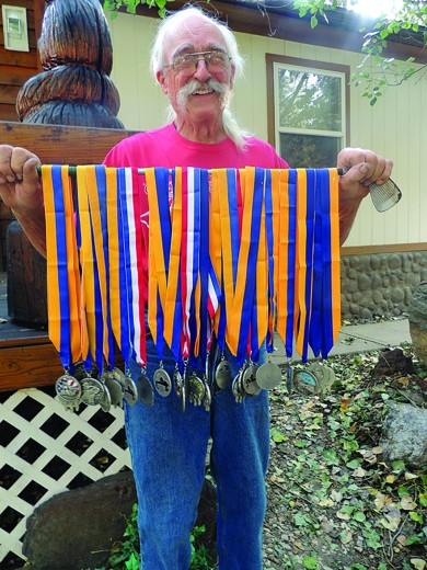 Gary Kuchar of Custer displays the nearly 30 medals he has received for each year he participated in the annual Crazy Horse Volksmarch.