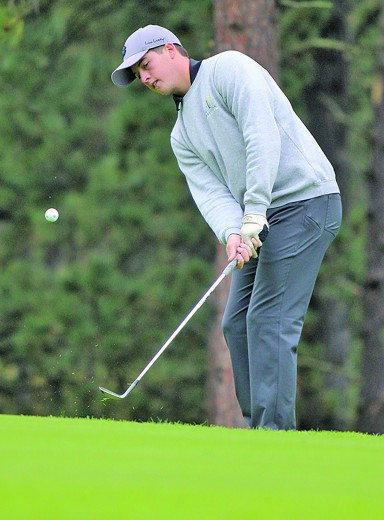 Dustyn Fish chips his ball onto the green during action at the Custer Invitational last Friday. Fish fired a round of 86 at the meet, which was good for fourth place.