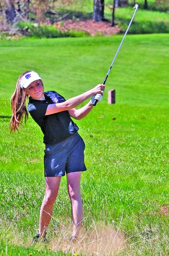 Lauryn Robb watches her shot out of the rough during action at last week's Hot Springs Invitational. Robb carded the second-best score for the Wildcats at the meet.
