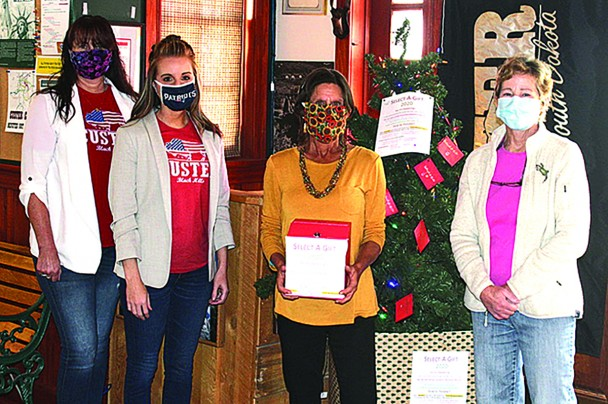 The annual Select A Gift is off to an early start this year and organizers are seeking cash donations only, with a goal of raising $12,000 by Dec. 1. This year's Select A Gift tree was put up at the Custer Area Chamber of Commerce office. From left are chamber office and events assistant Dawn Murray, chamber director Dolsee Davenport and Select A Gift committee members Julie Ames-Curtis and Meg Schwartz.